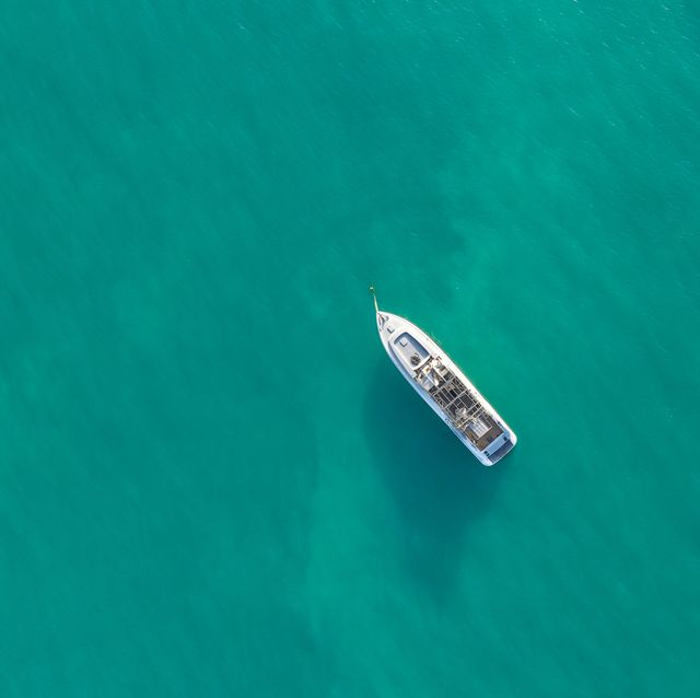 Aerial top shot of a luxurious yacht on the sea