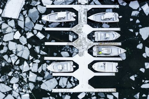Aerial view of boats in the icy sea, Ballstad, Norway