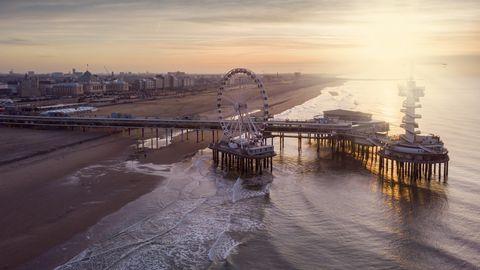aerial view on the ferris wheel on the pier at scheveningen at sunset