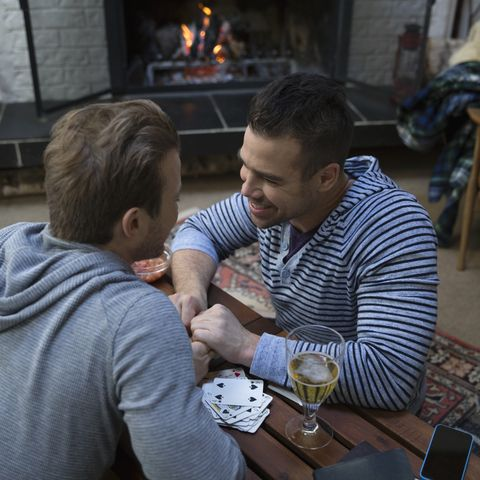 winter date ideas - Affectionate homosexual couple near fireplace in living room