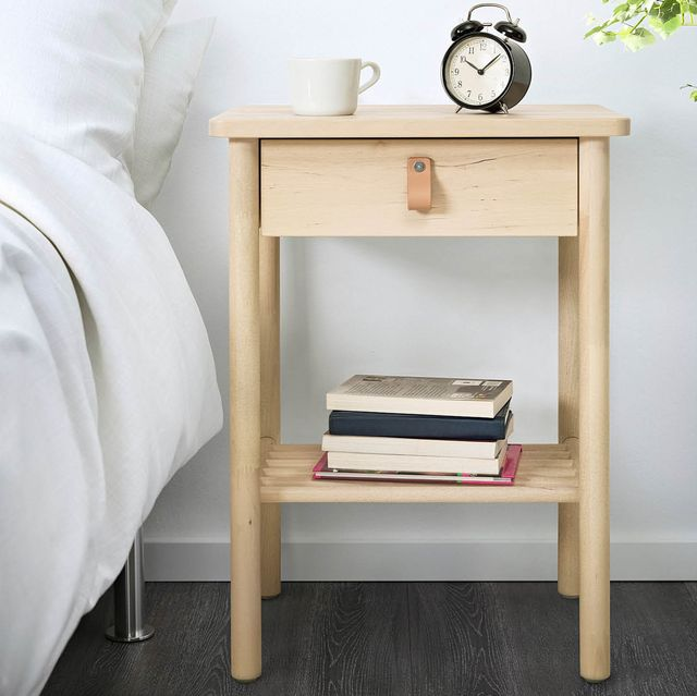 pink nightstand with vase and cup, wood nightstand with alarm cup, mug, and books
