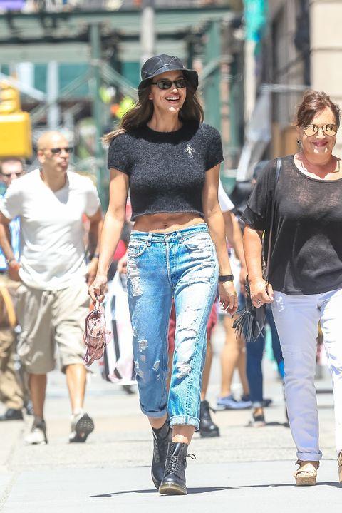 Clothing, Street fashion, Jeans, Fashion, Crop top, Walking, Eyewear, Sunglasses, Shoulder, Waist,