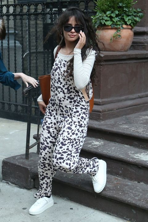 08092019 camila cabello makes a quick wardrobe change and heads out of an apartment with shawn mendes in new york city cabello stepped out with wet hair while wearing polka dot overalls, and white trainers mendes carried cabello's luggage to a waiting car salestheimagedirectcom please bylinetheimagedirectcom