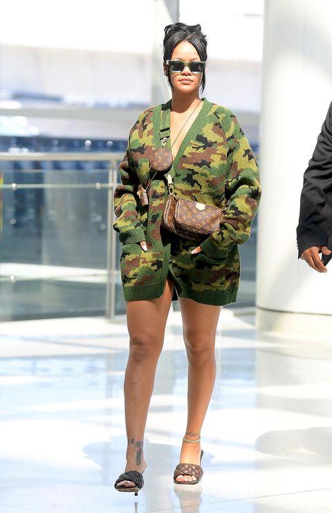Fashion model, Fashion, Fashion show, Clothing, Military camouflage, Runway, Eyewear, Camouflage, Fashion design, Military uniform,