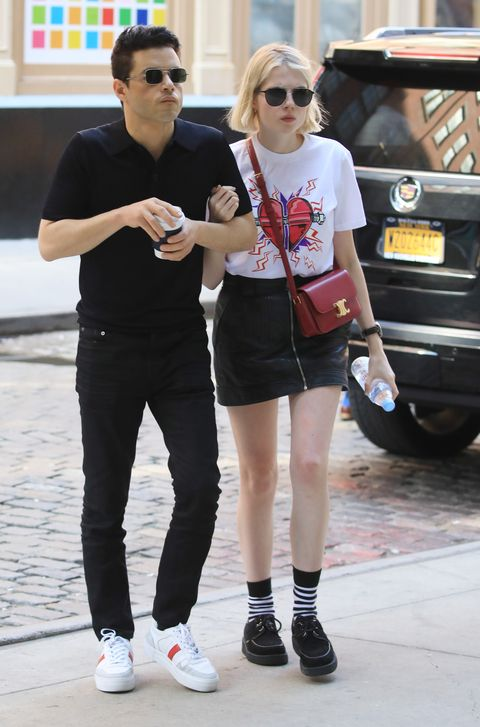 09262019 rami malek and lucy boynton are pictured stepping out in new york city malek, 38, wore a black shirt, matching trousers, and white trainers boynton, 25, carried a celine bag and wore a graphic t shirt, black leather miniskirt, striped socks, and black shoessalestheimagedirectcom please bylinetheimagedirectcom