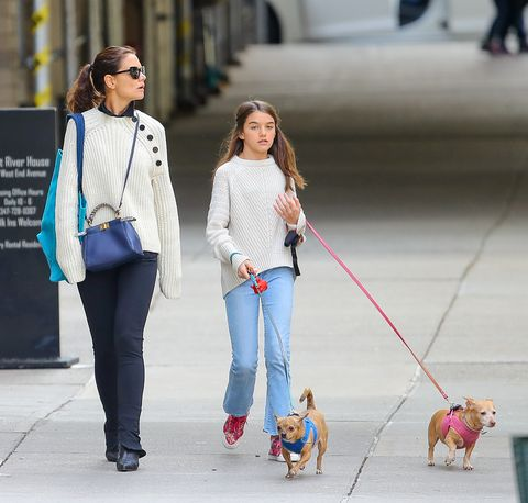 Dog walking, Leash, Street fashion, Walking, Fashion, Jeans, Companion dog, Waist, Outerwear, Footwear,