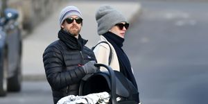 EXCLUSIVE: Anne Hathaway Steps Out with Adam Shulman Holding a Bassinet in Connecticut.