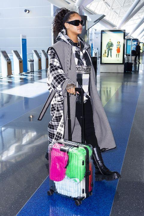 Street fashion, Clothing, Fashion, Shoulder, Outerwear, Sunglasses, Hand luggage, Eyewear, Travel, Fashion accessory,