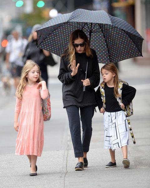 Umbrella, Street fashion, Fashion, Snapshot, Fashion accessory, Outerwear, Rain, Headgear, Child, Street,