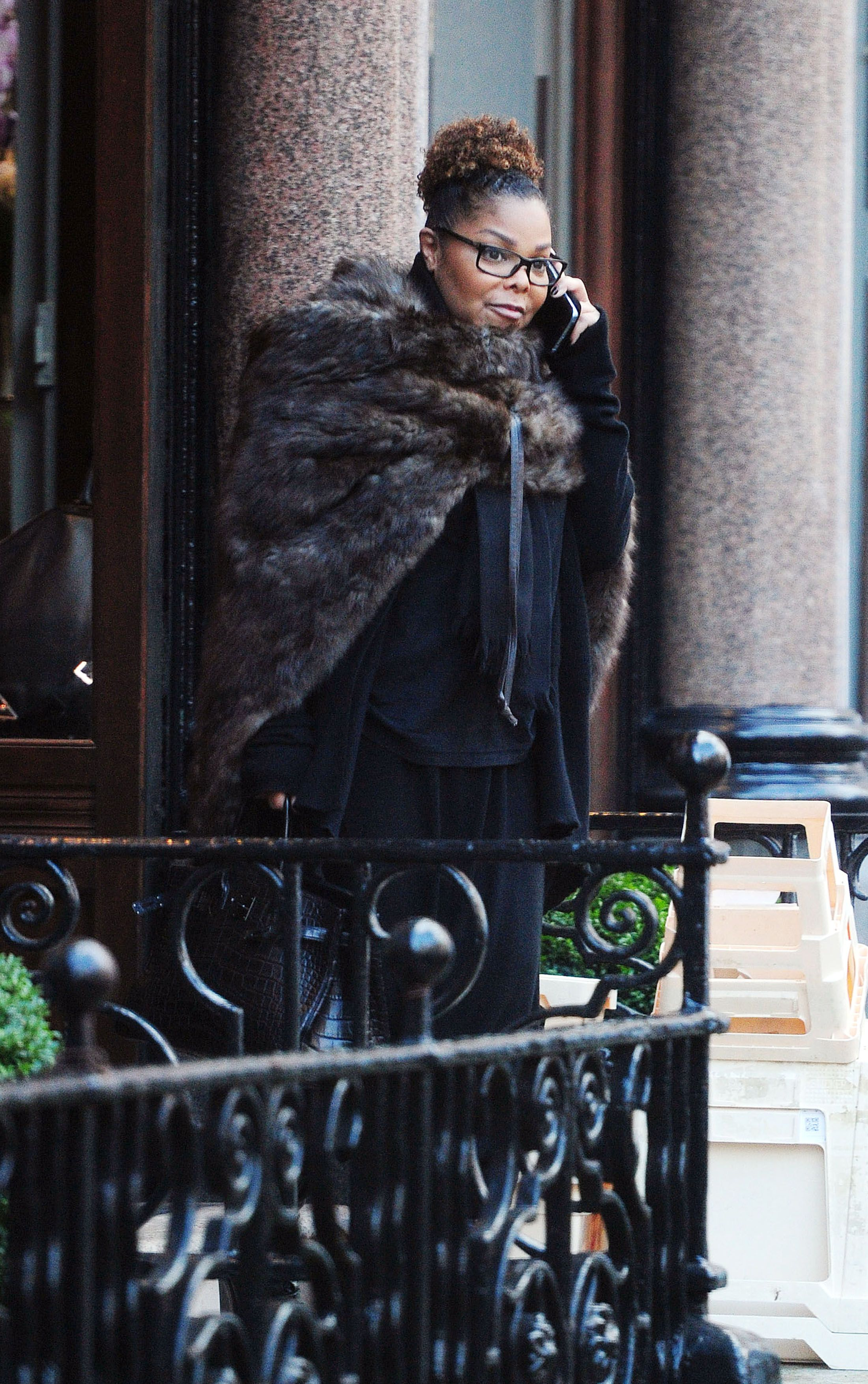 EXC - Janet Jackson show post baby figure while out in London