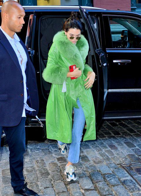 Vehicle door, Green, Clothing, Street fashion, Outerwear, Snapshot, Footwear, Fashion, Vehicle, Textile,
