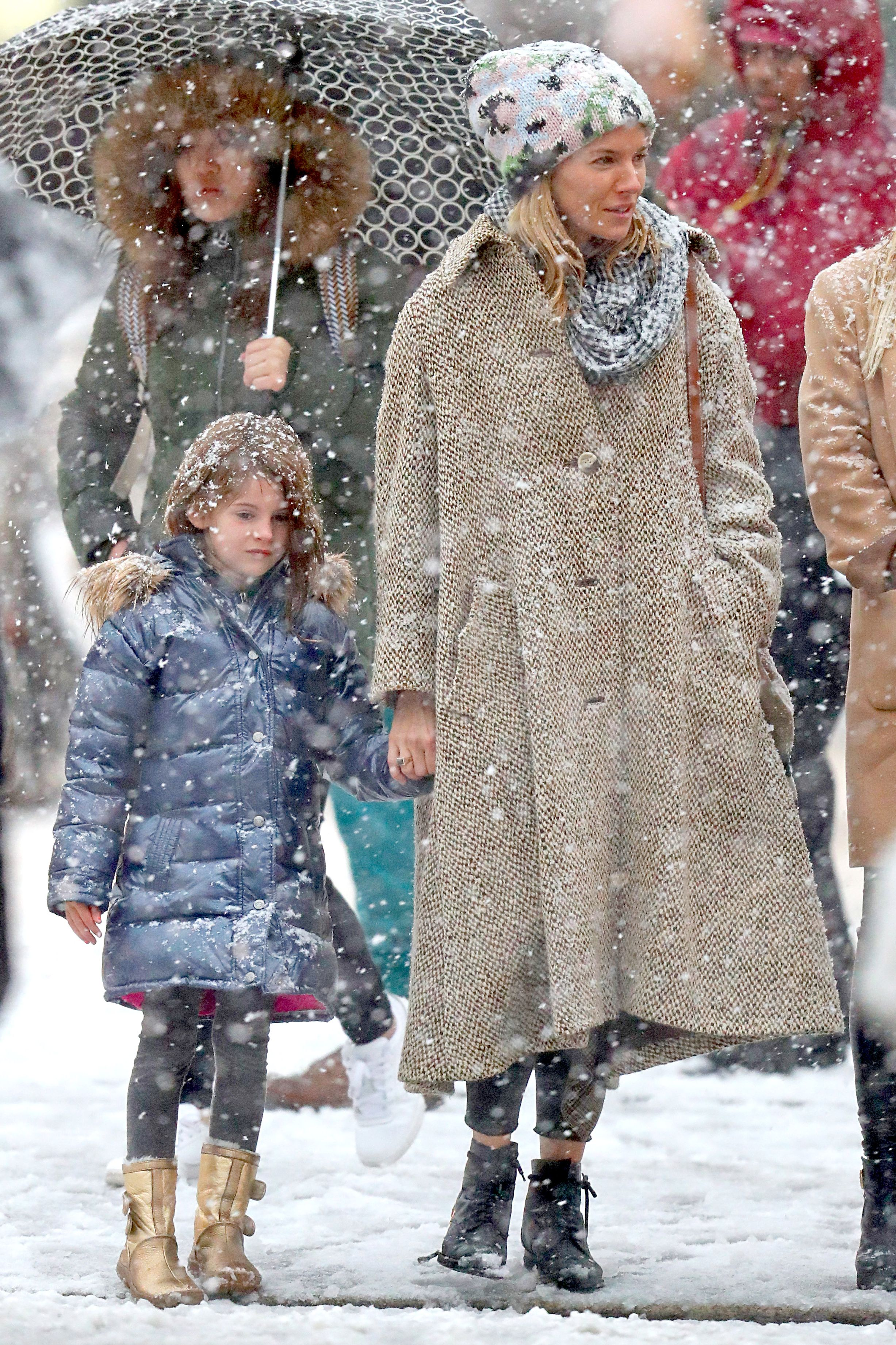 EXCLUSIVE: Sienna Miller is Spotted Stepping Out in a Snowstorm in New York City.