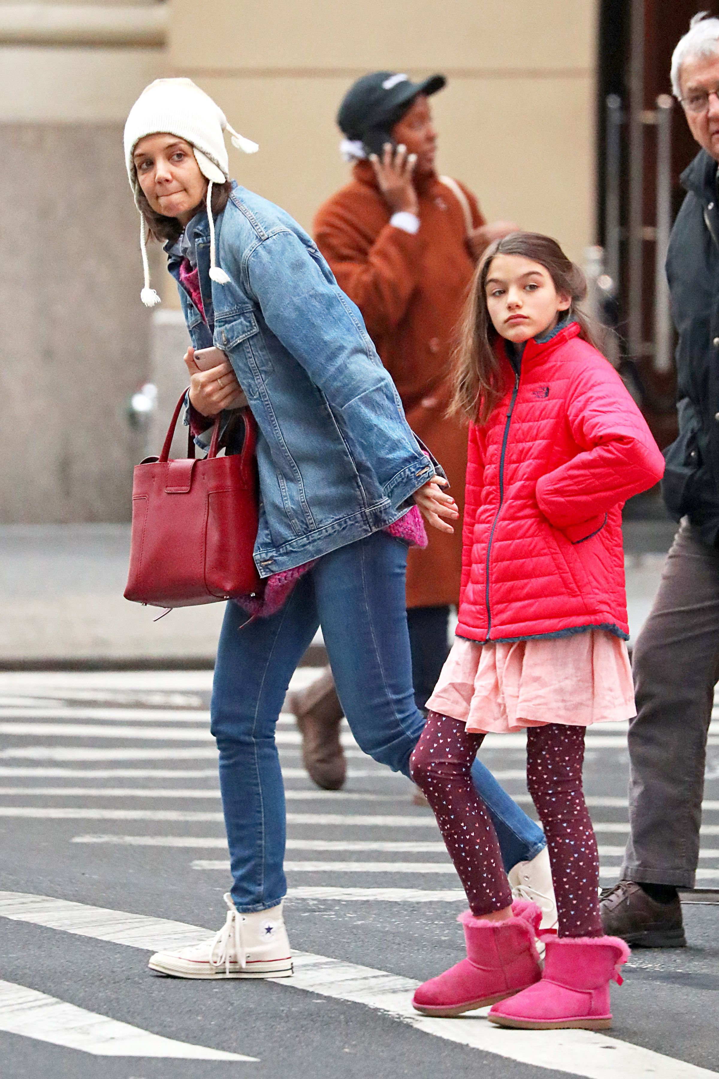 EXCLUSIVE: Katie Holmes Steps Out with Her Parents and Takes Suri Ice Skating in New York City.