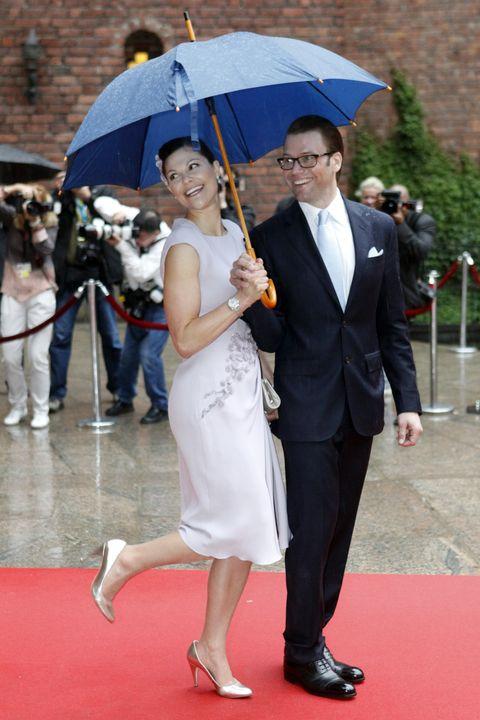 Red carpet, Umbrella, Snapshot, Event, Carpet, Fashion accessory, Formal wear, Dress, Flooring, Photography,