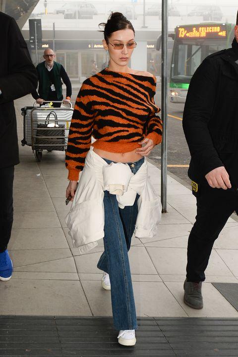Fashion, Jeans, Orange, Standing, Snapshot, Hairstyle, Street fashion, Human, Outerwear, Trousers,