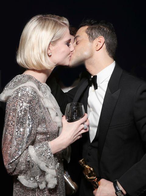 Photograph, Kiss, Interaction, Formal wear, Fashion, Romance, Suit, Cheek, Human, Lip,