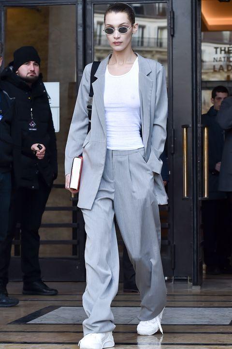 Eyewear, Sleeve, Trousers, Shoulder, Shoe, Standing, Collar, Outerwear, Style, Street fashion,