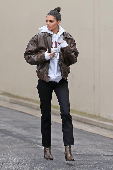 White, Clothing, Street fashion, Fashion, Jeans, Jacket, Outerwear, Standing, Dress shirt, Blazer,