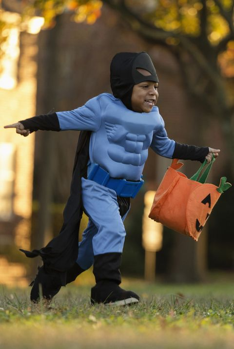 african american boy trick or treating on halloween