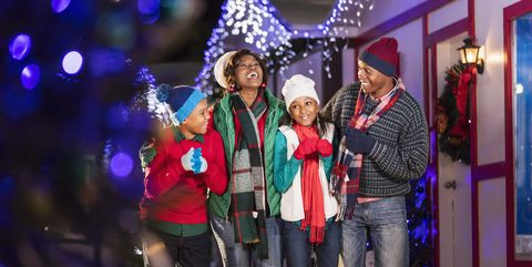 African-American family outdoors at Christmas