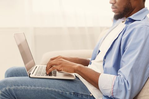 African-american man browsing work opportunities on laptop