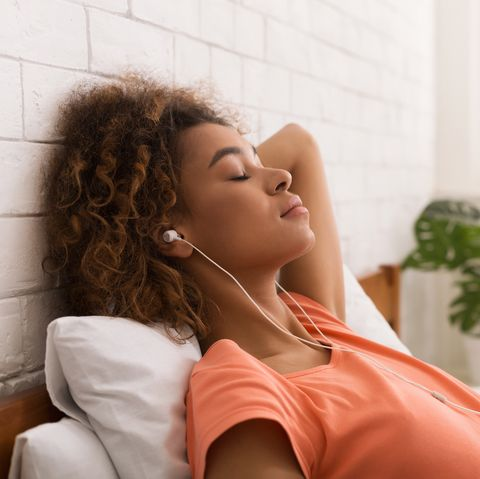 African-american woman relaxing and listening to music