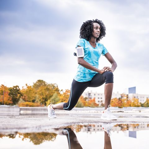 African American woman stretching before her run