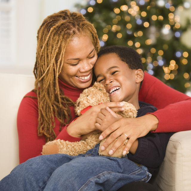 African mother hugging son at Christmas