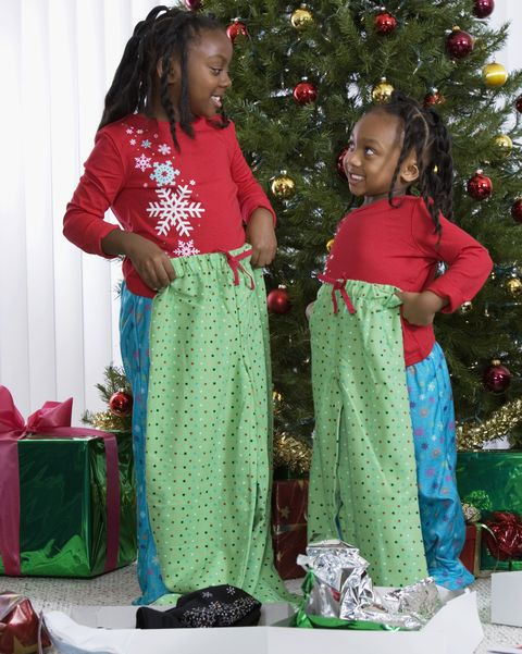 african sisters holding matching christmas gifts