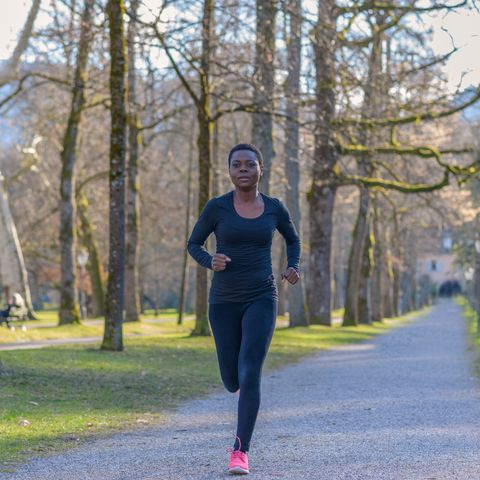 african woman jogging during her daily workout