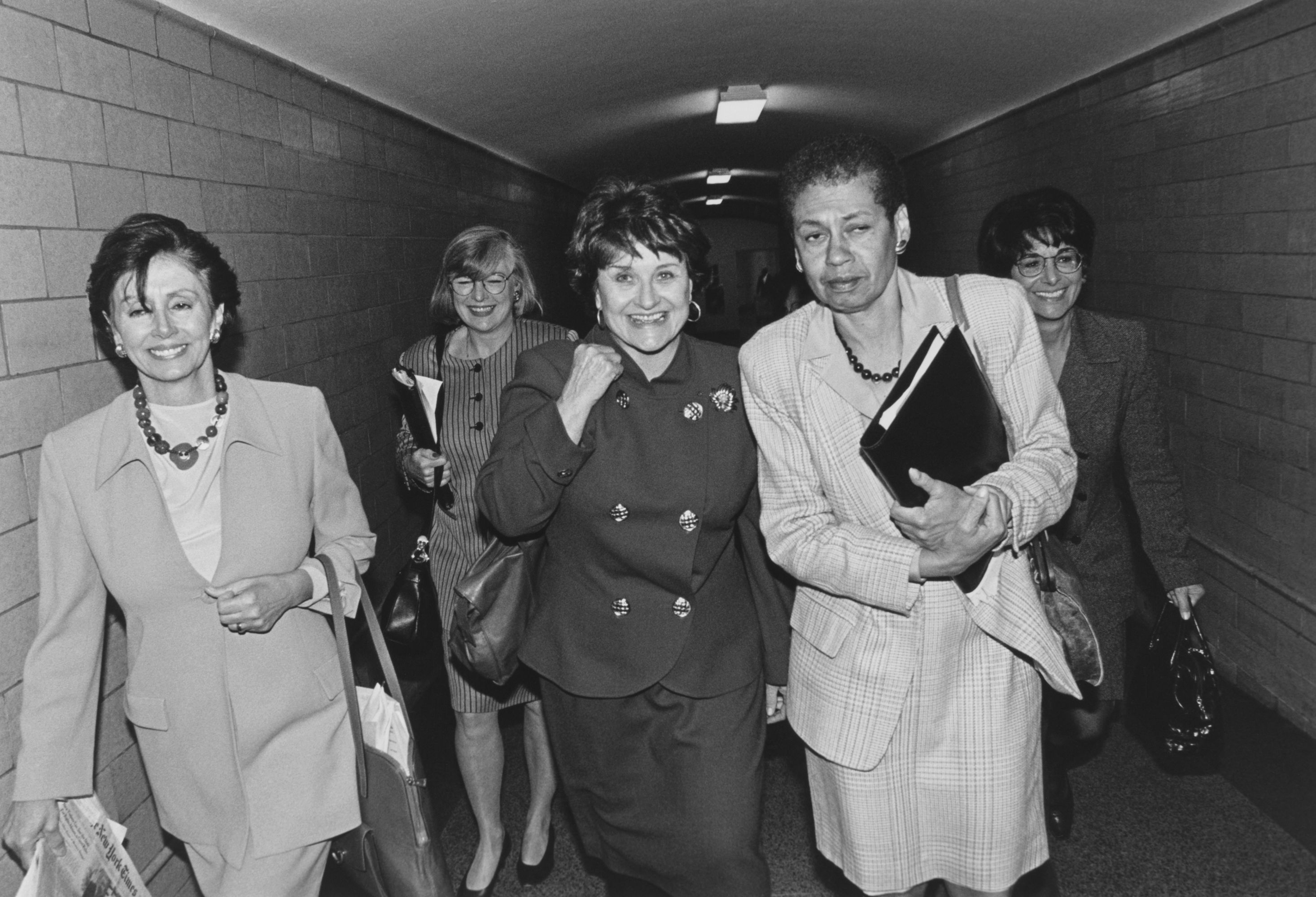 Pelosi is joined by party members and friends Louise Slaughter, Lynn Woolsey, and Anna Eshoo.