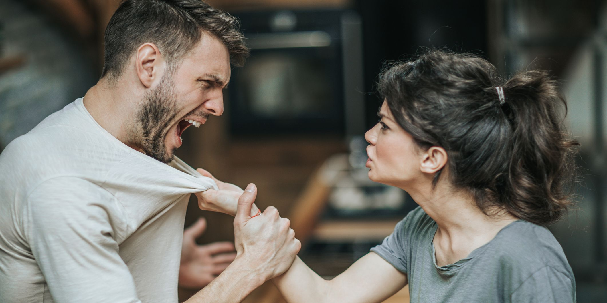 Aggressive couple arguing about their problems at home.