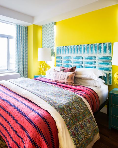 bedroom with yellow walls and pink bedding