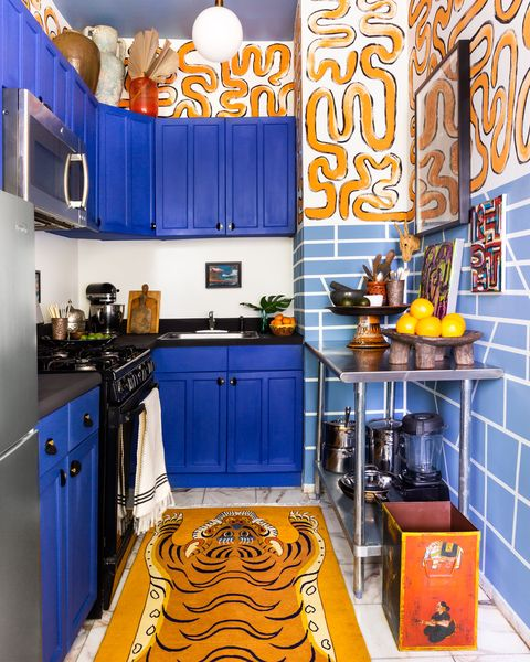 Orange, Room, Kitchen, Blue, Yellow, Furniture, Cabinetry, Countertop, Interior design, Building,