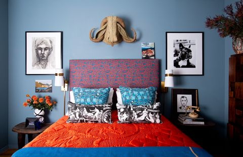 bedroom with blue walls and orange bedding