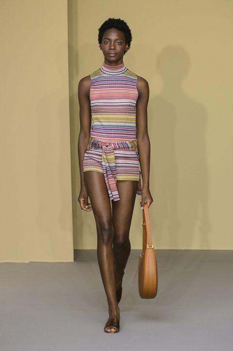 Fashion model, Fashion, Fashion show, Clothing, Runway, Shoulder, Model, Human leg, Leg, Fashion design,