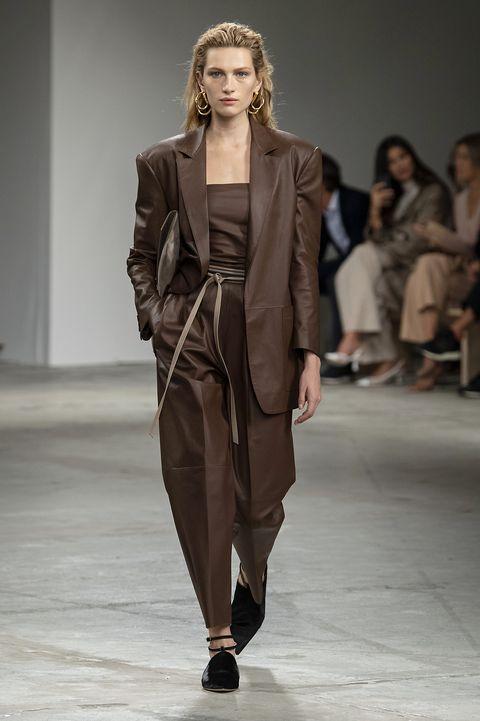 Fashion model, Fashion show, Runway, Fashion, Clothing, Outerwear, Human, Shoulder, Public event, Coat,