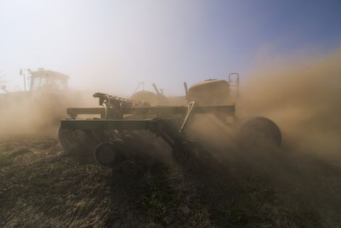agriculture   a john deere tractor and air seeder planting garbanzo beans chick peas in the rolling hills of the palouse region  near pullman, washington, usa