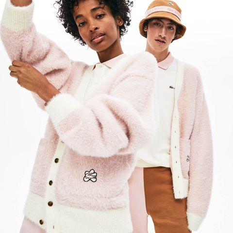 White, Clothing, Outerwear, Sweater, Pink, Sleeve, Gesture, Uniform, Fur, Top,