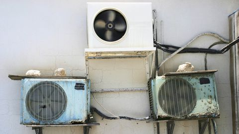 Air conditioning units on the side of a building.