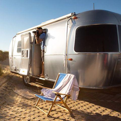 Vehicle, Transport, Travel trailer, Mode of transport, Trailer, Horse trailer, RV, Caravan, Car, Landscape,