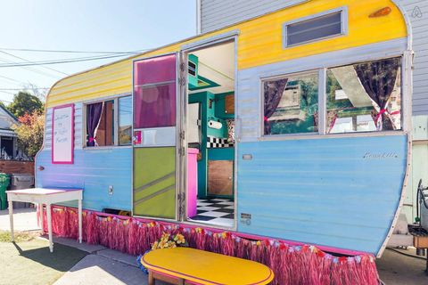 Pink, House, Building, Architecture, Facade, Room, Vehicle, Interior design, Furniture, Home,