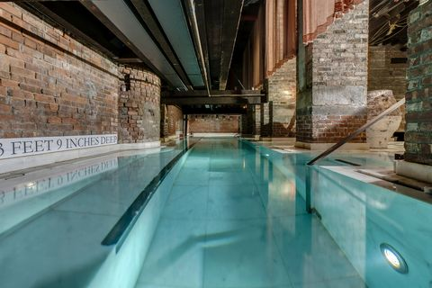 Swimming pool, Blue, Water, Architecture, Building, Leisure, Real estate, Thermae, Reflection, Interior design,