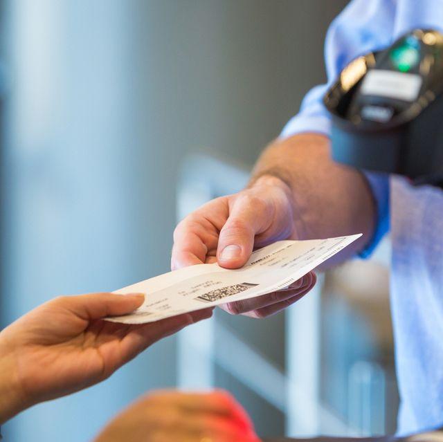 airline attendant scanning airplane ticket
