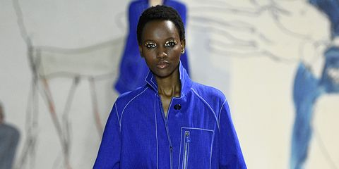 Blue, Face, Fashion, Cobalt blue, Electric blue, Human, Fashion design, Smile, Outerwear, Adaptation,