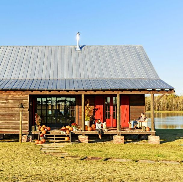 rustic dogtrot cabin with red doors and shutters