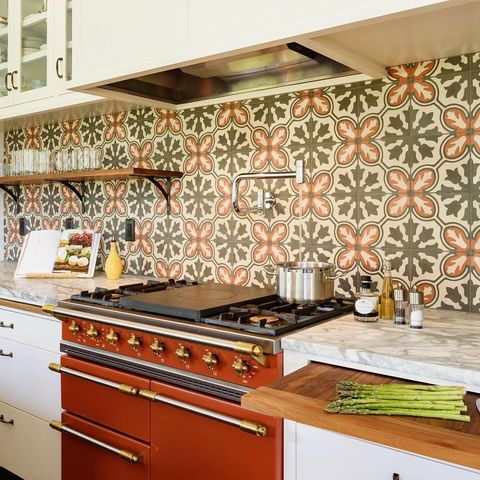 Countertop, Kitchen, Tile, Room, Property, Orange, Kitchen stove, Interior design, Cabinetry, Wallpaper,