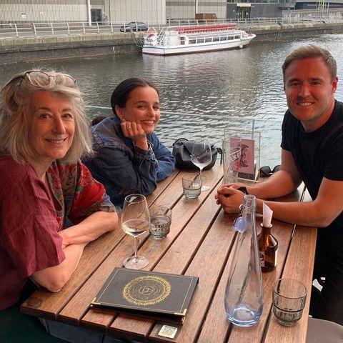 alan halsall, maureen lipman and ruxandra porojnicu sitting in a bar next to the water