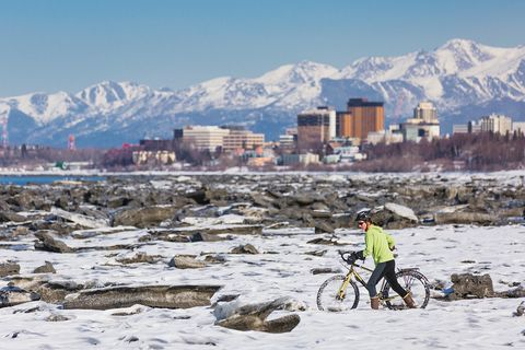 Winter, Mountain, Snow, Cycling, Bicycle, Sky, Mountain range, Vehicle, Tourism, Recreation,