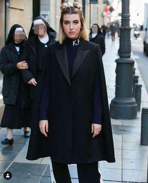 Clothing, Street fashion, Fashion, Outerwear, Overcoat, Coat, Mantle, Headgear, Cape, Style,